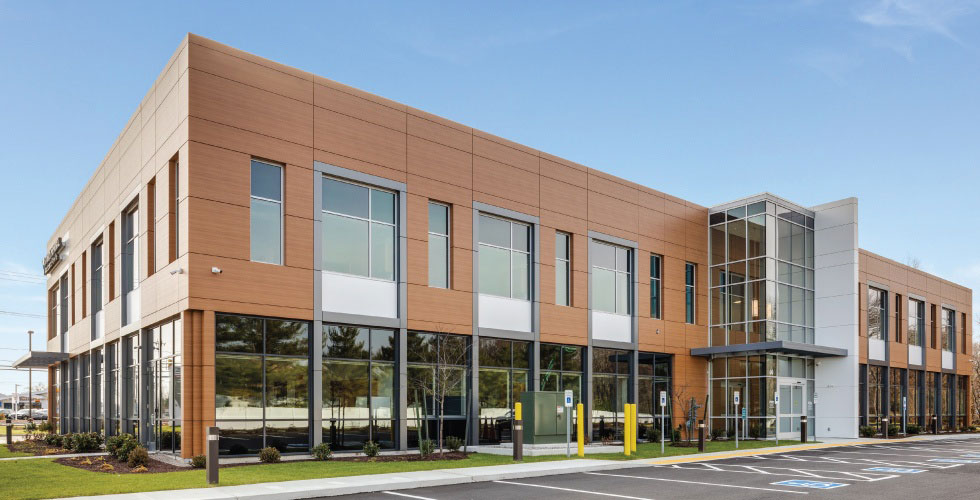 Stunning Medical Building Features Imported Wood Grain Metal